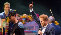 Prince Harry performs onstage with Coldplay