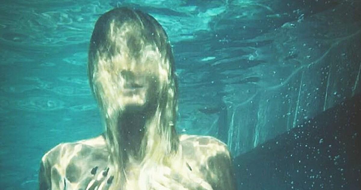 Heidi Klum Poses Topless Underwater in Series of Sultry