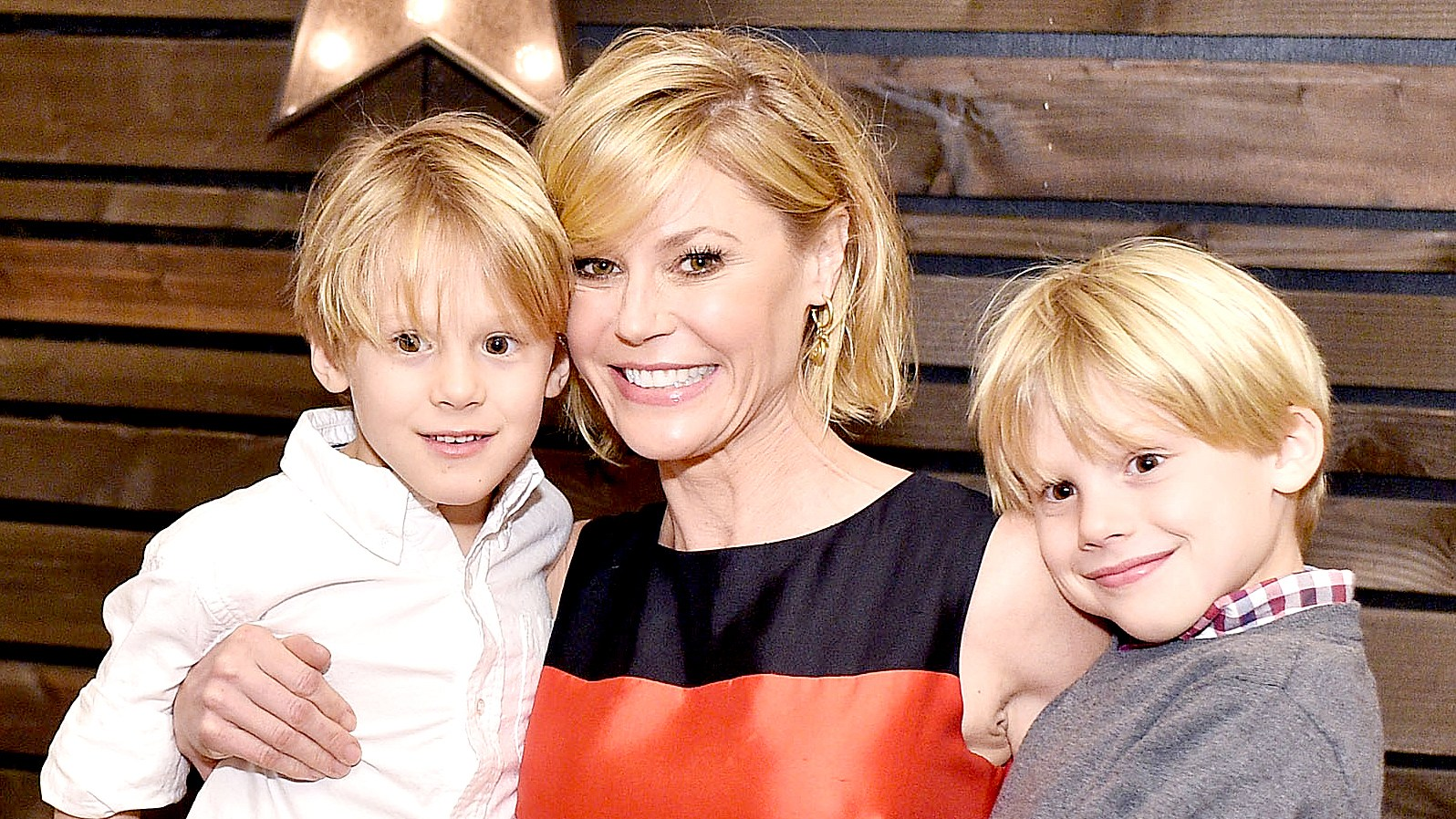 Julie Bowen and sons attend the Baby2Baby Holiday Party Presented By Tiny Prints At Montage Beverly Hills on December 6, 2015 in Beverly Hills, California.
