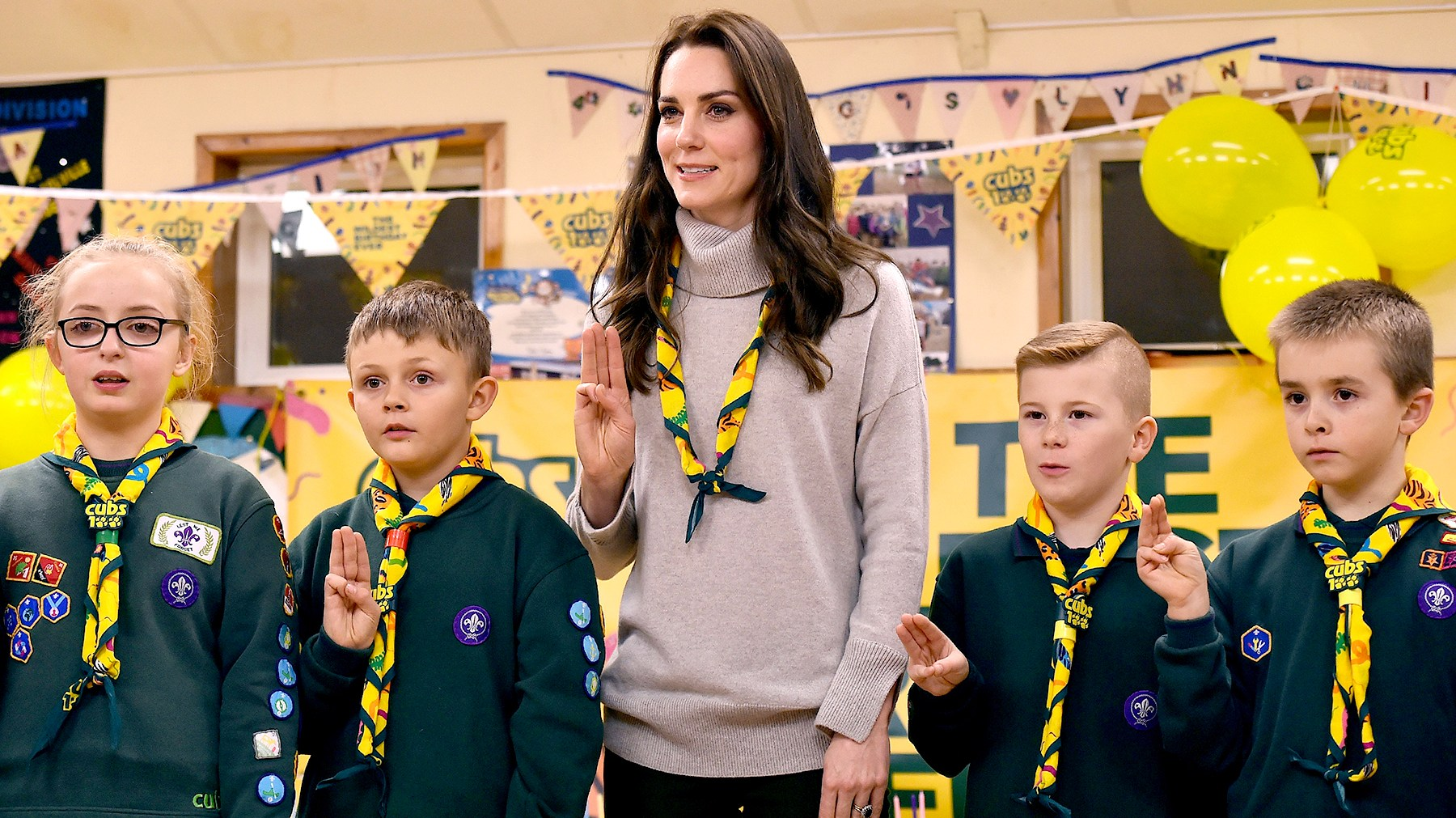 Britain's Catherine, Duchess of Cambridge (C), reads the Scouts promise during a Cub Scout Pack meeting with cubs from the Kings Lynn District, in Kings Lynn, eastern England, on December 14, 2016, to celebrate 100 years of Cubs. The Duchess attended a special Cub Scout Pack meeting with Cubs from the Kings Lynn District to celebrate 100 years of Cubs. Cub Scouting was co-founded by Robert Baden-Powell and Vera Barclay on the 16th December 1916.