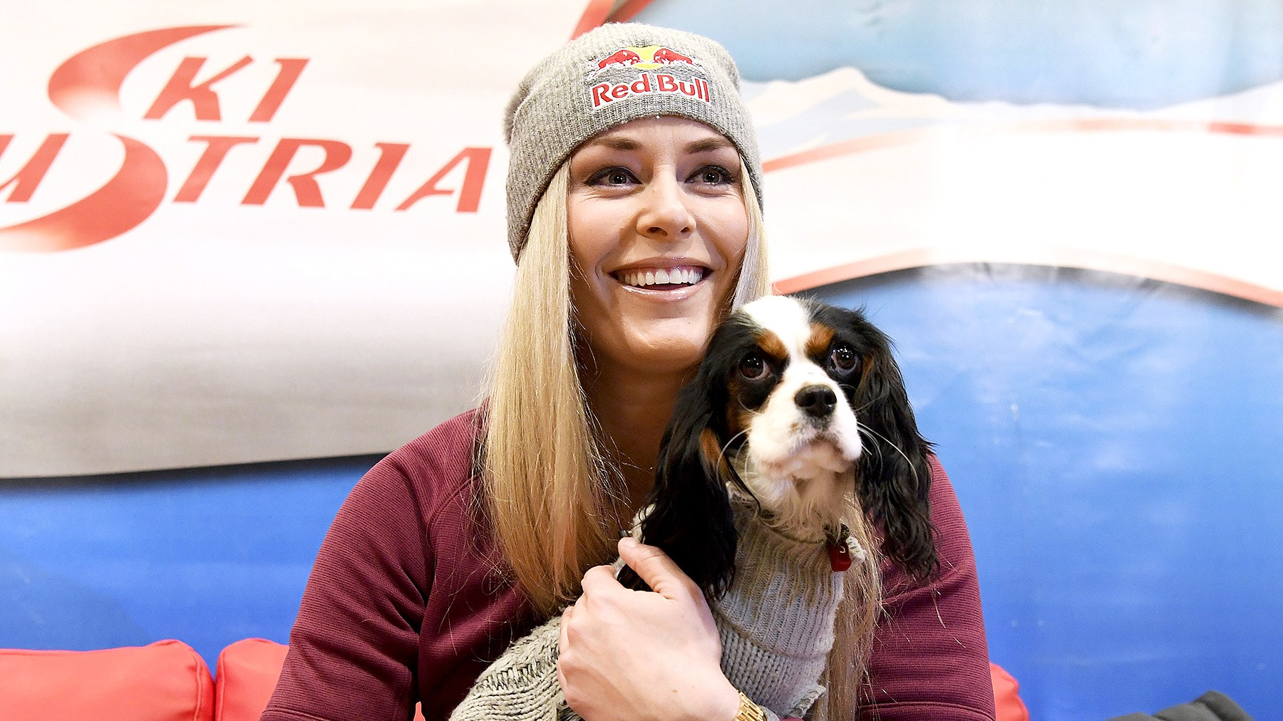 Lindsey Vonn and her dog Lucy are pictured during a press conference in Zauchensee, Austria, on January 12, 2017.