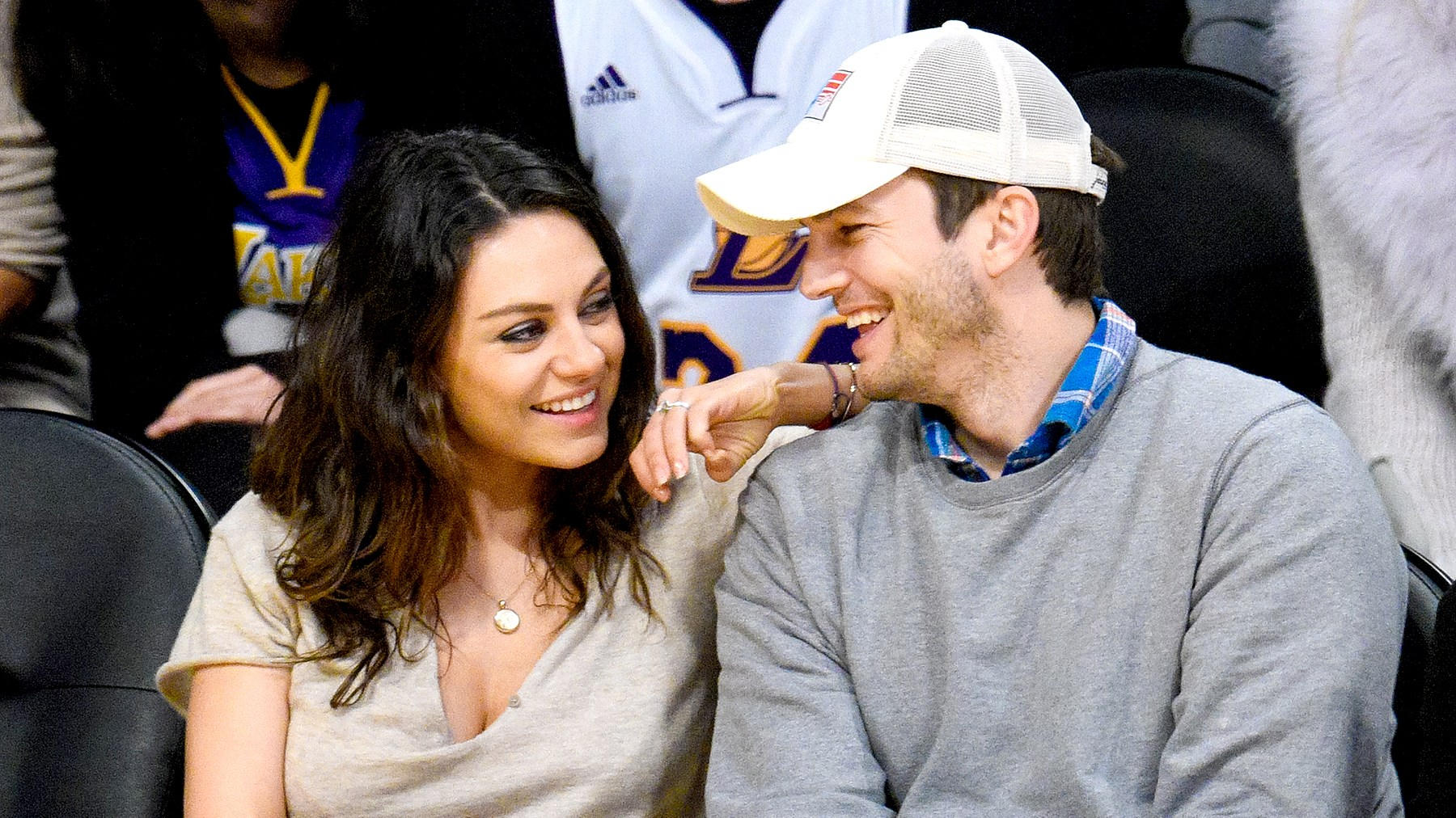 Mila Kunis and Ashton Kutcher attend a basketball game between the Oklahoma City Thunder and the Los Angeles Lakers at Staples Center in Los Angeles on December 19, 2014.
