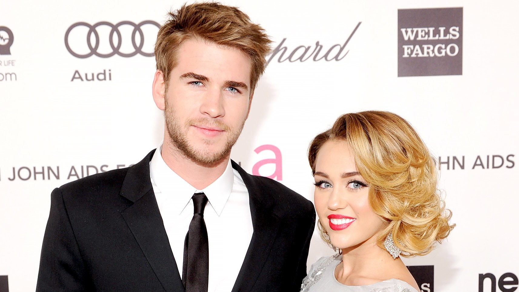 Liam Hemsworth and Miley Cyrus arrive at the 20th Annual Elton John AIDS Foundation Academy Awards Viewing Party at The City of West Hollywood Park on February 26, 2012 in Beverly Hills, California.