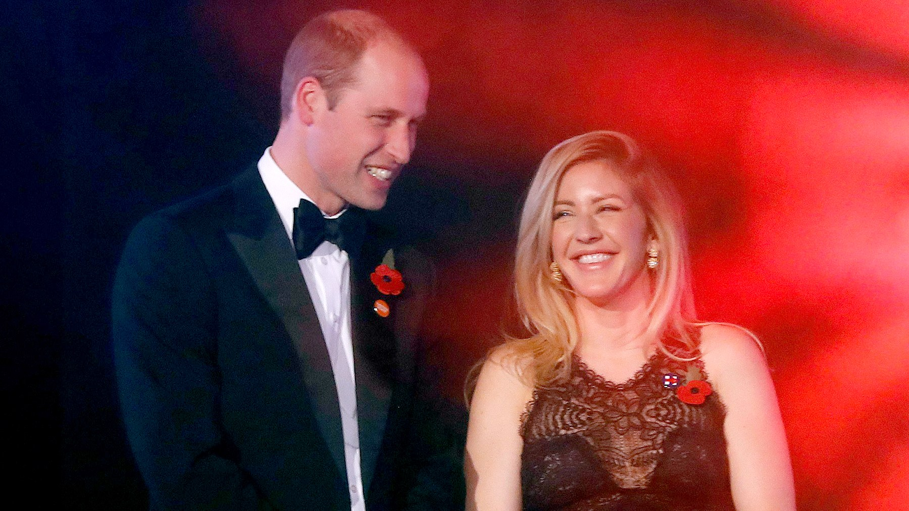 Britain's Prince William (L), The Duke of Cambridge speaks to British singer-songwriter Ellie Goulding (R) as they attend Centrepoint at the Palace, a fundraising event in the grounds of Kensington Palace in London on November 10, 2016 in aid of youth homeless charity Centrepoint.
