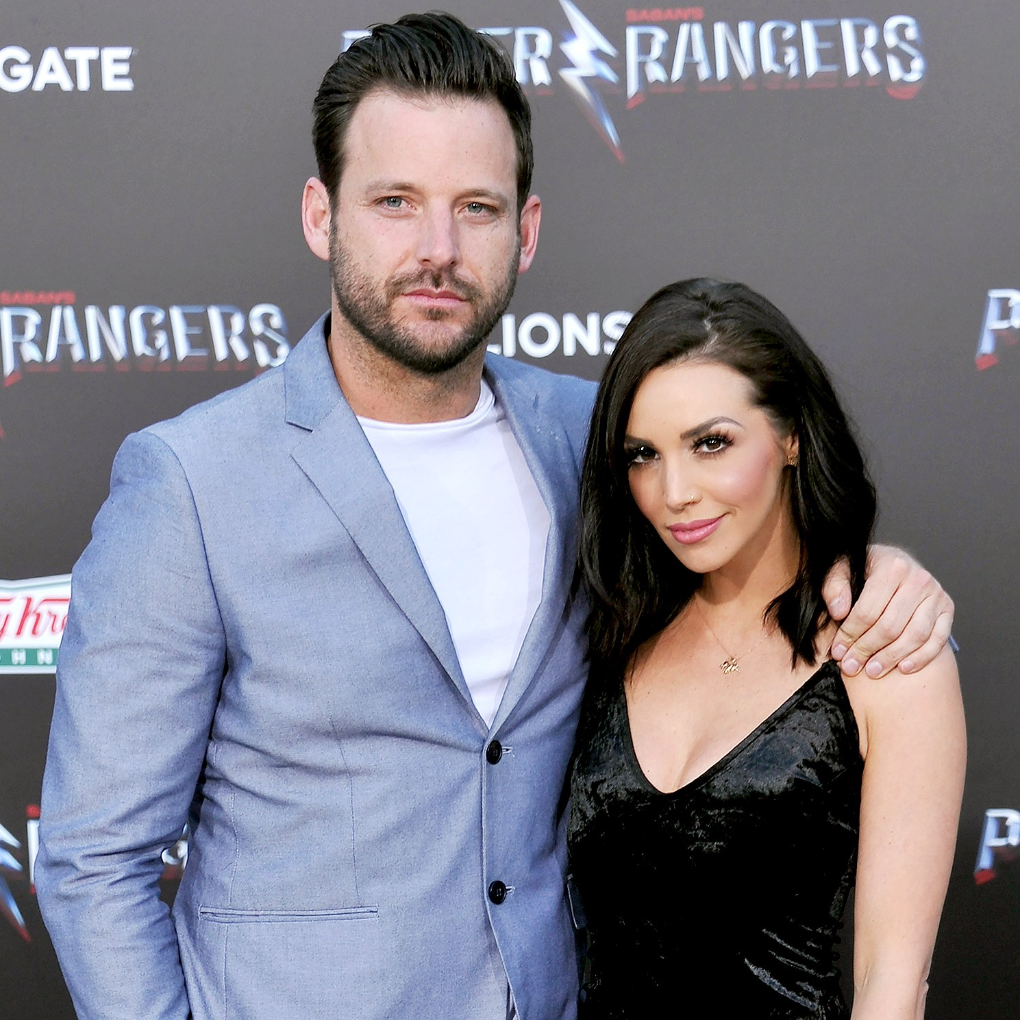"""Robert Valletta and Scheana Marie Shay arrive at the premiere of Lionsgate's """"Power Rangers"""" at The Village Theatre on March 22, 2017 in Westwood, California."""