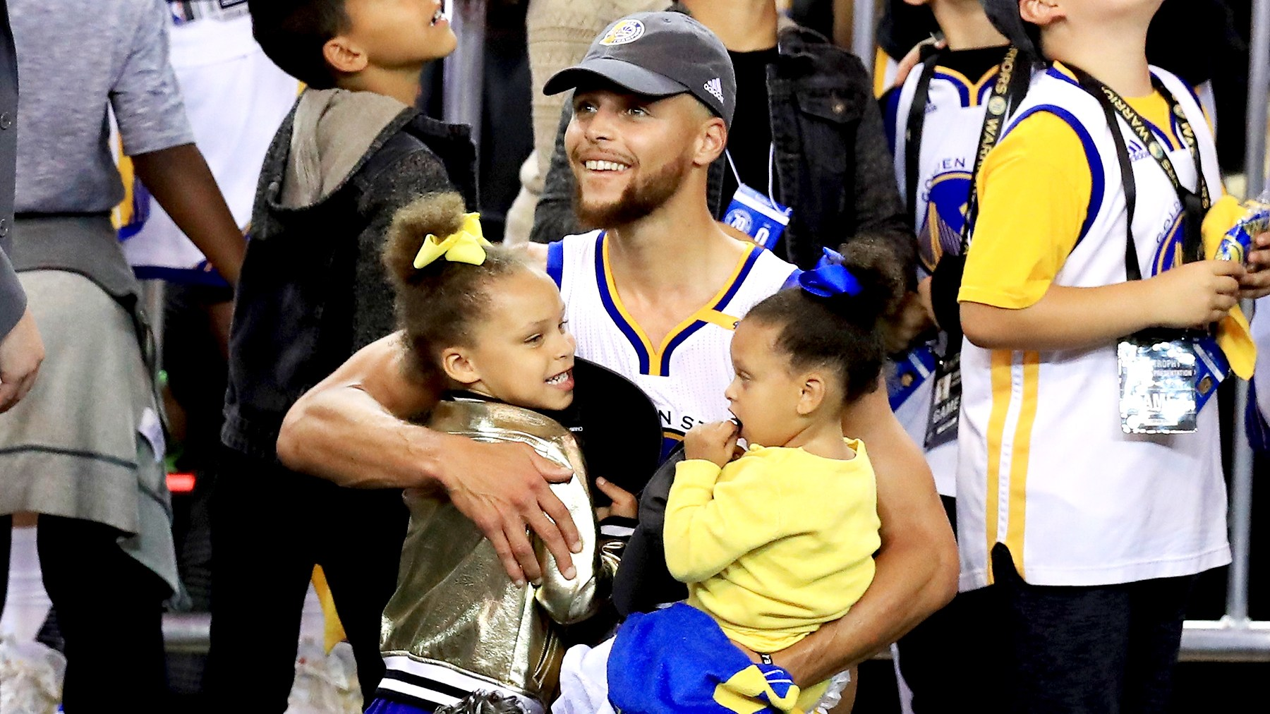 Stephen Curry #30 of the Golden State Warriors celebrates holding his daughters Riley and Ryan after defeating the Cleveland Cavaliers 129-120 in Game 5 to win the 2017 NBA Finals at ORACLE Arena on June 12, 2017 in Oakland, California.