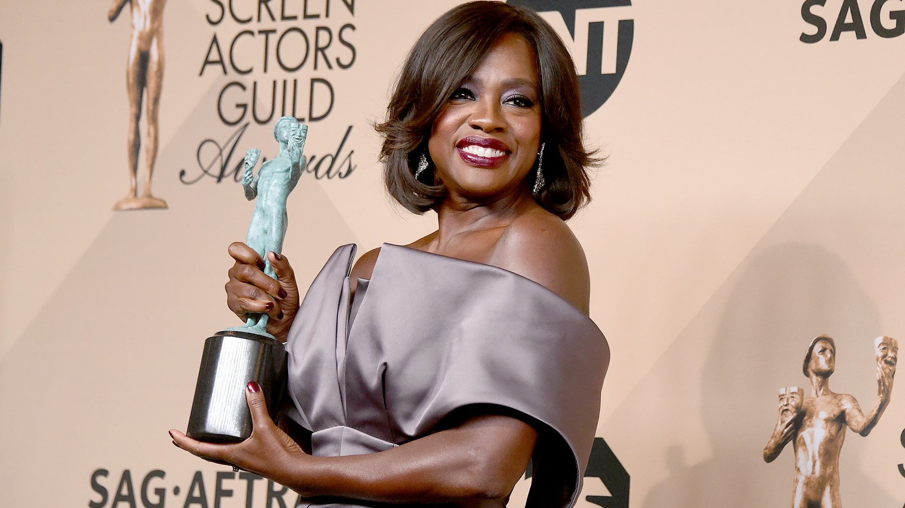 Viola Davis poses with her Screen Actors Guild award for outstanding performance by a female actor in a drama series.