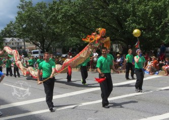 2013 7 4 US Martial Arts instructors and students parading the Dragon at the Towson 4th of July Parade Timonium, Maryland