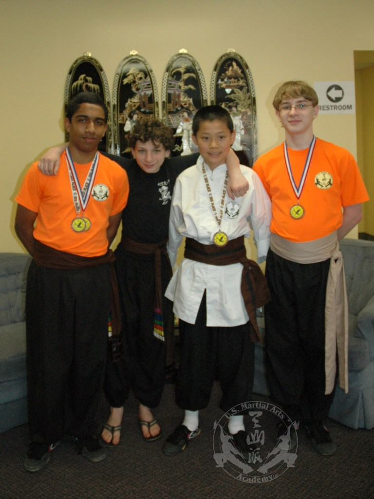 U.S. Martial Arts Academy, Ltd. students - volunteers and medal winners at Grandmaster Huang