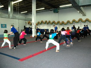 Family Kung Fu class at US Martial Arts Academy, Ltd in Timonium, Md. 7 instructors (wearing royal blue shirts) working with the students and two more also teaching but not seen in picture.