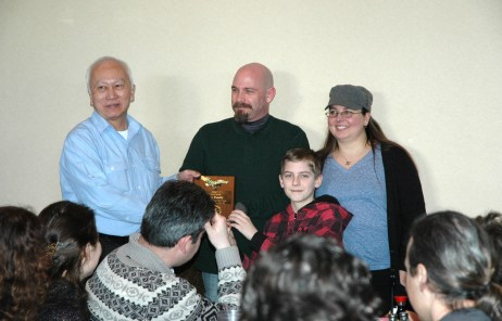 Grandmaster Huang giving a Tien Shan Pai Spirit award at the 2015 Feb. 22, Chinese New Year luncheon at Tokyo Seafood Buffet, Security Blvd., Windsor Mill, MD. 21244 -- students and staff from U.S. KuoShu Academy, Owings Mills, Maryland, U.S. Martial Arts Gaithersburg, U.S. Martial Arts Academy, Ltd, Timonium, Freedom Martial Arts, Bel Air