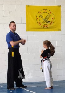 Showing respect in the Kung Fu Kids class at US Martial Arts Academy, Ltd, Timonium, MD 21093, www.usmaltd.com 410-561-9882 ©2015 Maricar Jakubowski All rights reserved. No usage allowed in any form without the written consent of the photographer.