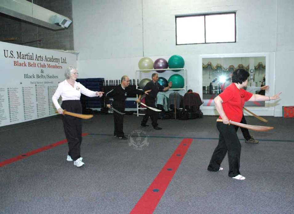 Broadsword form in Adult Tai Chi class at U.S. Martial Arts Academy, Ltd. Timonium Maryland U.S.A. www.usmaltd.com 410-561-9882 ©2015 Maricar Jakubowski All rights reserved. No usage allowed in any form without the written consent of the photographer.