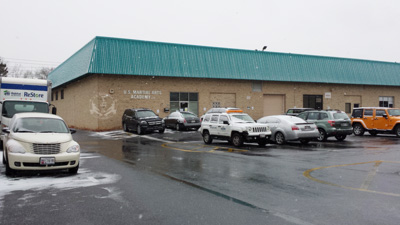 US Martial Arts Academy, Ltd building and parking lot January 7, 2017 - Light Dusting of Snow and wet parking lot
