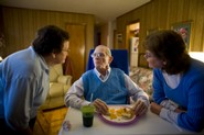 Eighty one-year-old Robert Stack of Orange, Virginia, is cared for in his home by his wife, Beverly (light blue sweater), and a private nurse named Ellen Colvin (dark blue sweater).
