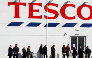Tesco closes off non-essential sections of stores in England 1