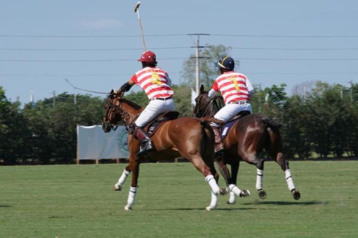 Navy teammates Alejandro Novillo Astrada and Karl Hilberg working together downfield. Photo courtesy ChukkerTV.
