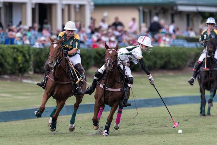 Most Valuable Player Hope Arellano of Bendabout shoots on the nearside, The Villages Teresa Connelly in defense.