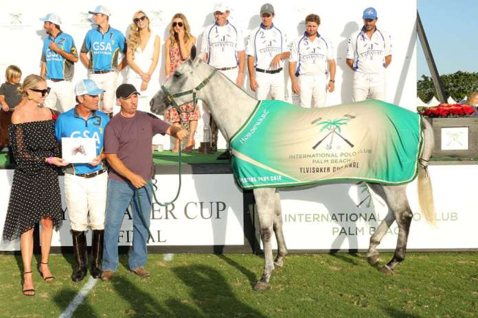 "Best Playing Pony Ylvisaker Cup Final: Macarena owned and played by Mariano Gonzalez, presented by Amy Jackson on behalf of NetJets and Four Seasons Resort, pictured with Gerardo ""Lalo"" Ugarte."