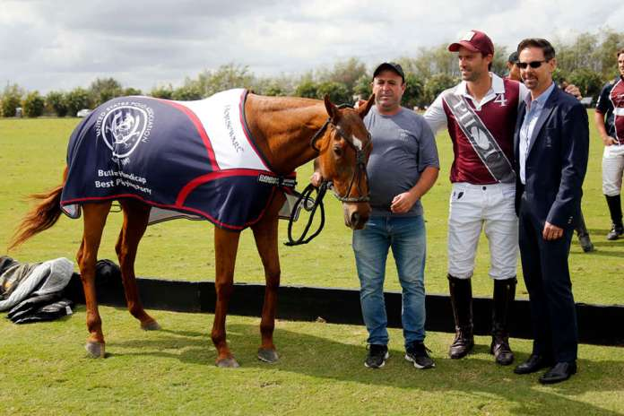 Best Playing Pony: Open Kattia, played and owned by Facundo Pieres, presented by USPA CEO Bob Puetz, pictured with Javier Fiel.