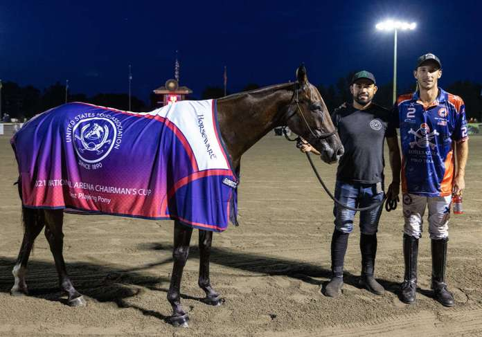 Best Playing Pony Yatay Alcon, played by Tolito Fernandez Ocampo and owned by Bill Ballhaus. Pictured with groom Josue Tercero.