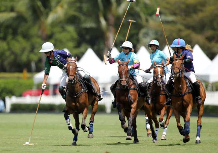 BTA/The Villages' Kylie Sheehan running with the ball ahead of Hawaii Polo Life's 10-goaler Hazel Jackson.