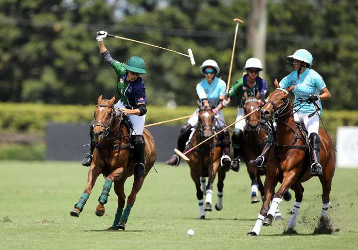 BTA/The Villages' Paige Boone hitting the nearside backhand under pressure from Hawaii Polo Life's Mia Cambiaso.