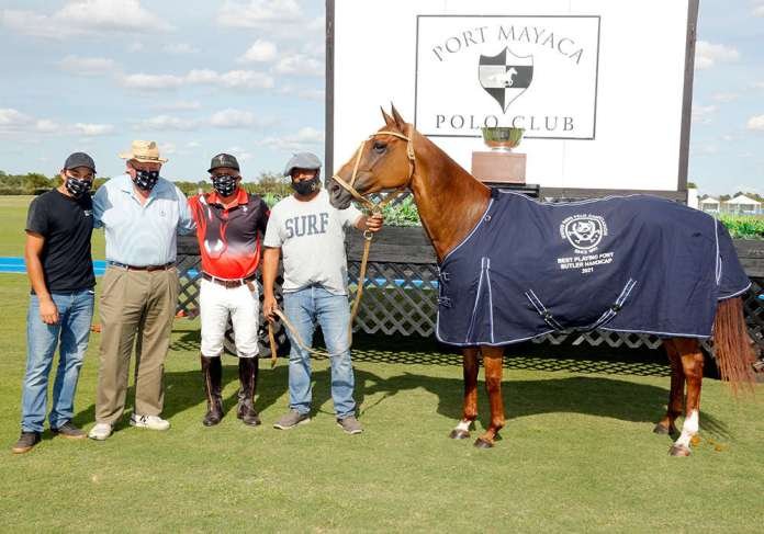 Best Playing Pony Chela, played and owned by Mariano Aguerre. Pictured with Naca Nicora, Peter Orthwein and Gustavo Echeverria.