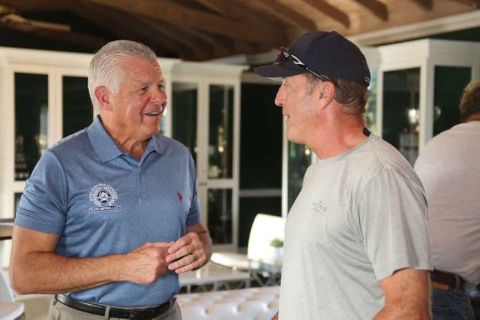 Bob Delaney speaking with Club President and Lucchese team owner John Muse.