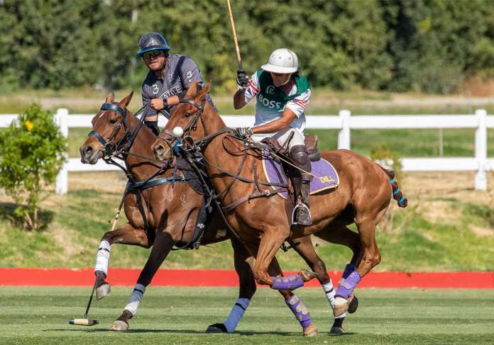Boss Polo's Felipe Vicente preparing a swing on the nearside while engaged with Casa S3's Toto Socas.