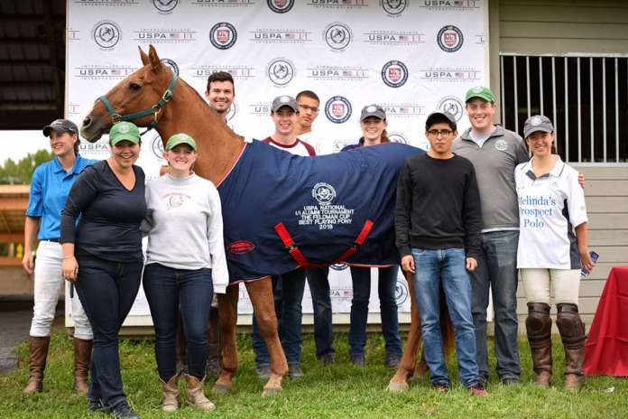 Feldman Cup Best Playing Pony Clarita, owned by Epic-Skidmore and played by Morgan O'Brien, pictured with the Skidmore Collegiate Team.