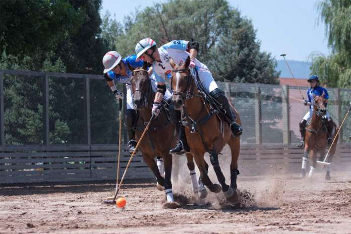 Grant Ganzi of Casablanca keeps possession with Carlitos Gracida of The Polo School defending.