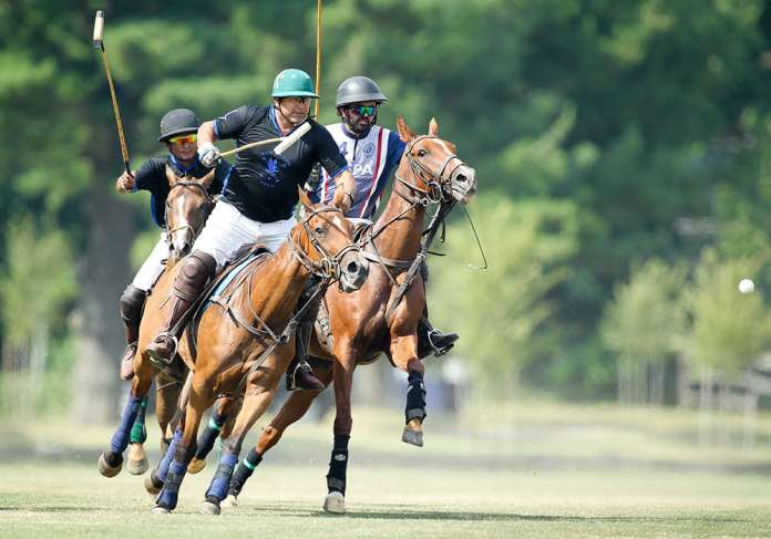 Hawkwood's Juan Martinez-Baez and USPA Polo Development's Nate Berube battle for possession.