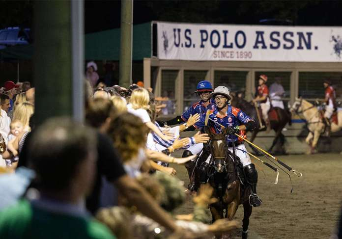 Tolito Fernandez Ocampo and Tareq Salahi celebrate with the excited crowd at Twilight Polo Club.