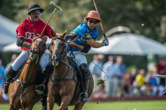 GSA's Toro Ruiz goes for the nearside, Audi's Mariano Aguerre riding hard to defend.