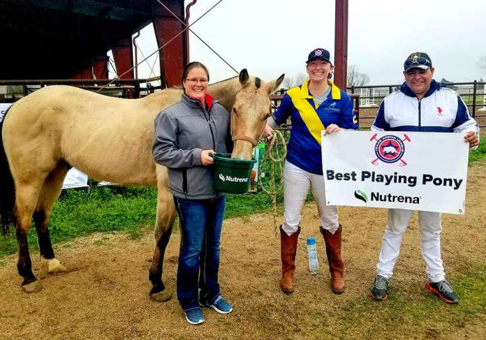 Megan Mitchell of Jackrabbit Tack presents the Best Playing Pony award to John Wayne, played by Amanda Massey and owned by Javier Insua.