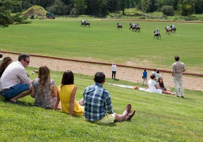 Spectators enjoying polo and sunshine at NYC Polo Club. ©Sarah Corbin