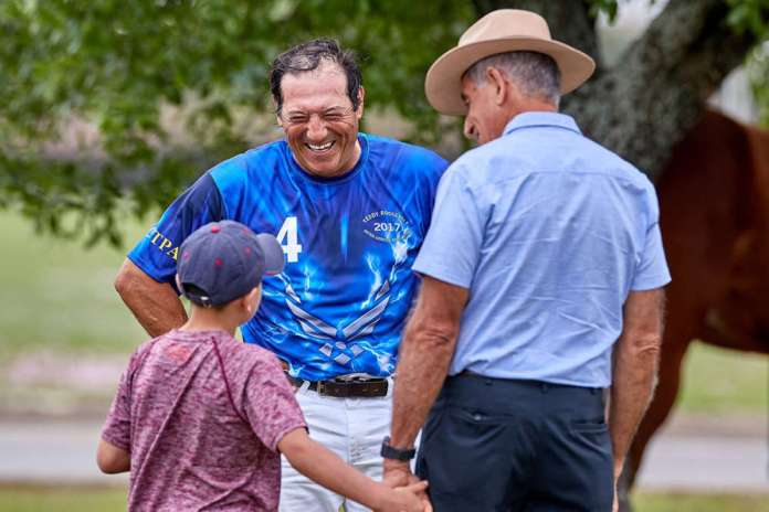 Pud Nieto, Air Force team members and South Padre Island Polo Club manager, talks with spectators at halftime.