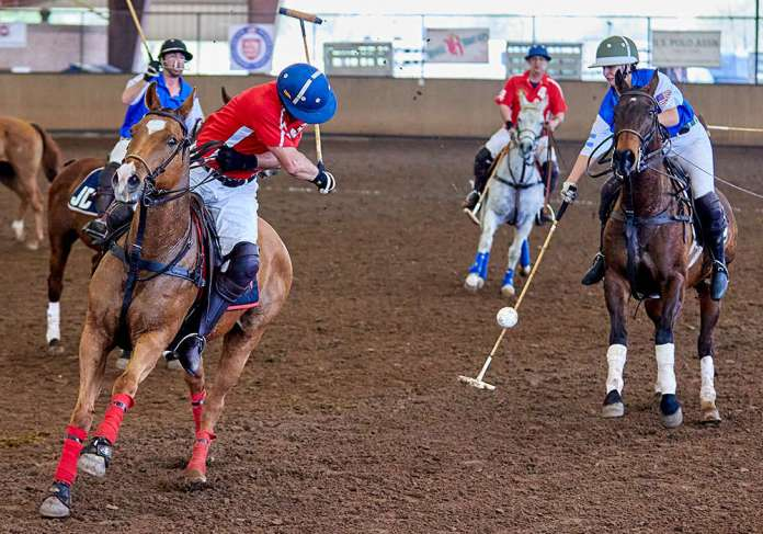 Two Wishes' Ariel Rodriguez backshot being defended by JD Polo's Katerina Kotova.
