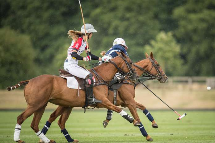 Girl power: USA's Hope Arellano carries the ball on the nearside, England's Milly Hine in pursuit.