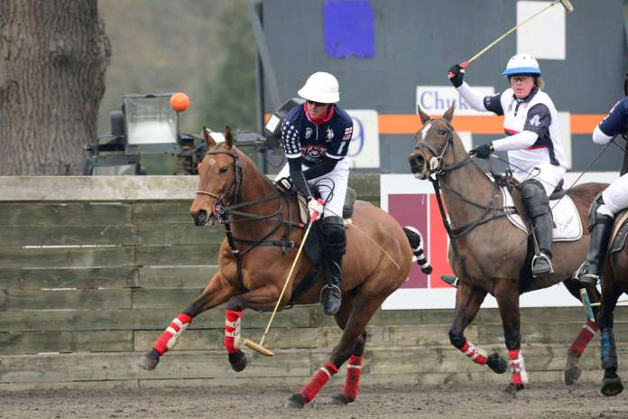 USA's Tommy Collingwood takes the ball on the nearside.