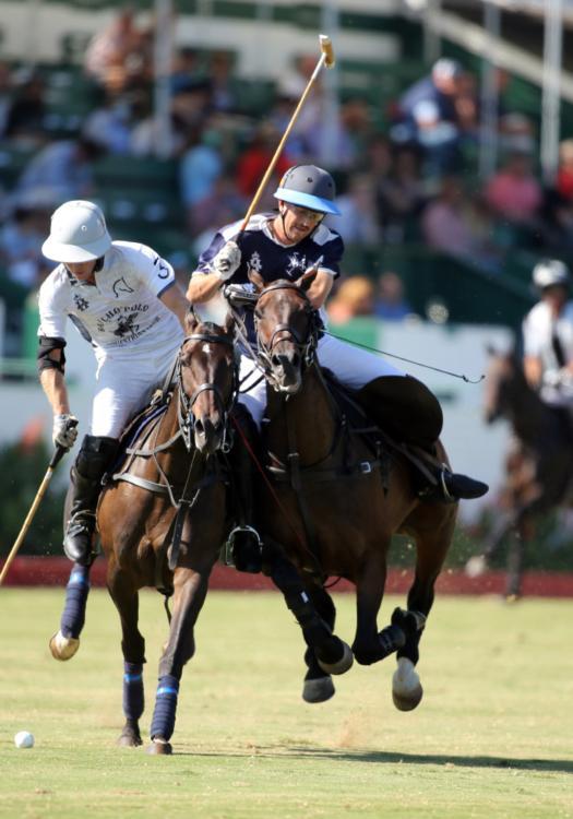 Rancho Polo/Chogan Alejandro Gonzalez concentrates on the ball while Klentner Ranch's Tony Uretz embraces contact.