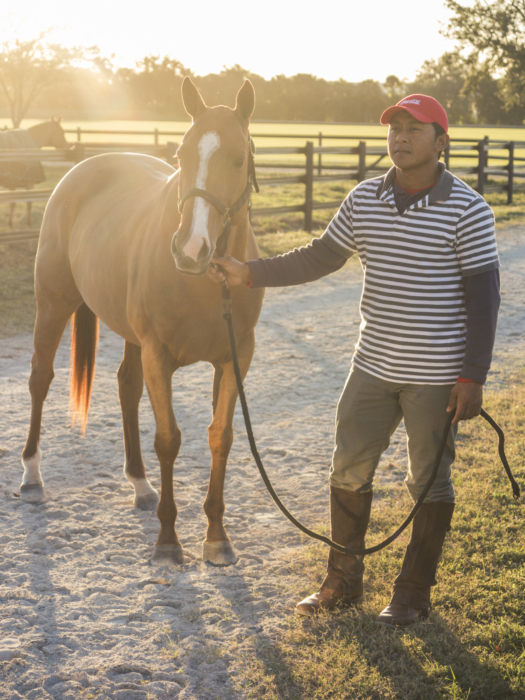 Lola poses with Coca-Cola Groom Sergio Arias at Everglades Polo Club.