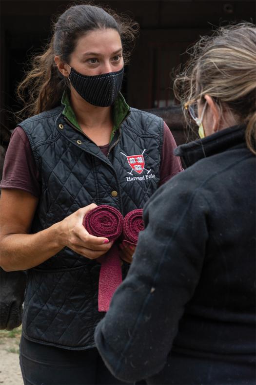 Danielle Lussi shows participants how to roll wraps. ©Deborah Bai-Lannon