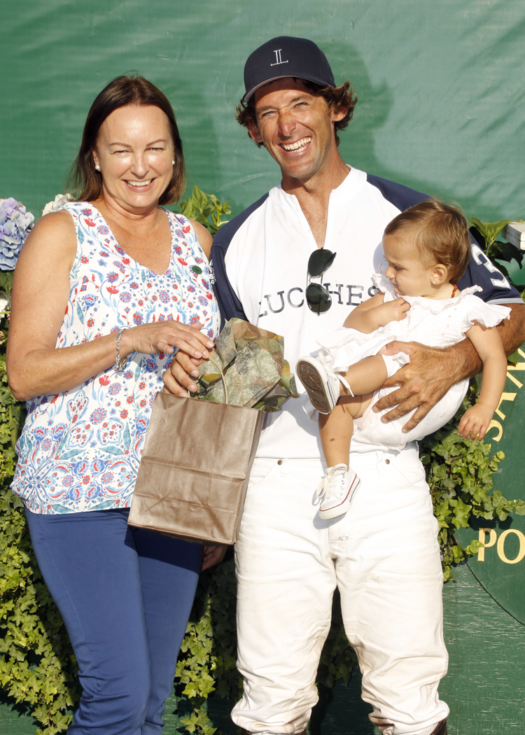 Kelly Smith Remmling from Jackson Hole Horse Emporium presented the Most Valuable Player Award to Agustin Molinas.