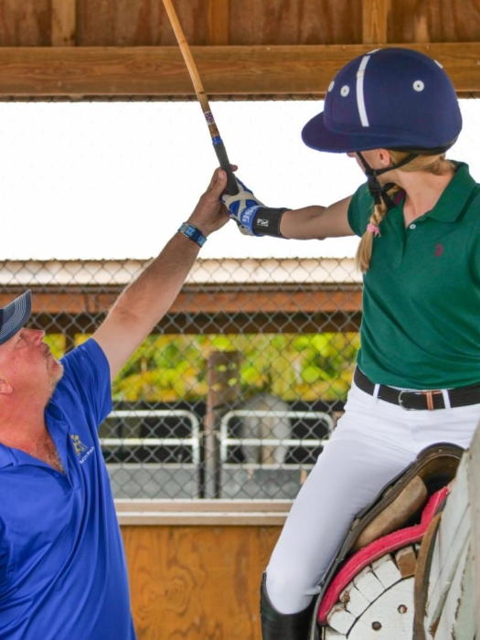 Joey Casey instructs a student in the hitting cage. ©Shelley Heatley.