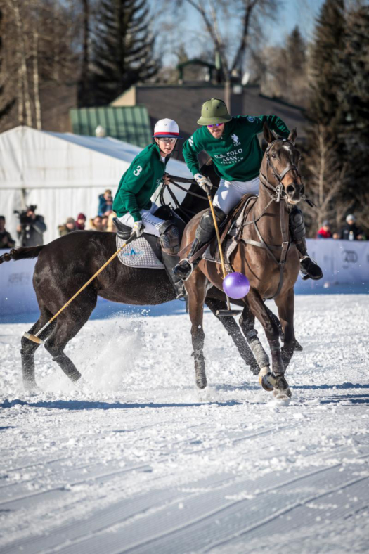 Nic Roldan of U.S. Polo Assn works the ball in the air with teammate Juancito Bollini backing him up.