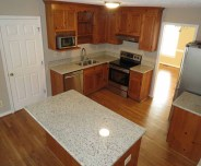 new appliances, countertops and flooring throughout