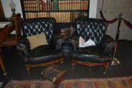 Two McAllister-owned unrestored leather chairs with footstool. Photo courtesy of Sherrie Horn.