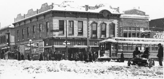 Busy Corner after a snowstorm in 1921 (Credit: Penrose Library Digital Collection).